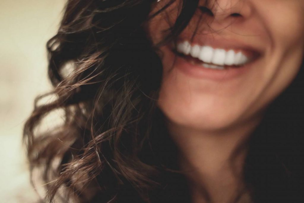 woman smiling with straight teeth